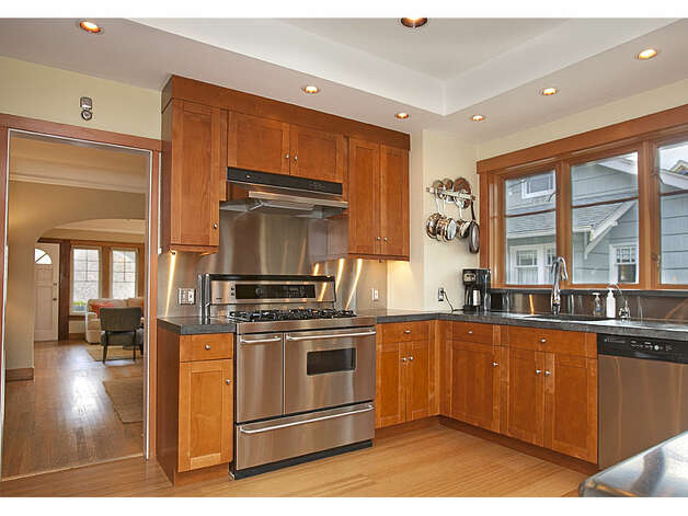 Kitchen of 337 26th Ave. The 2,580-square-foot house, built in 1914, has four bedrooms, 1.75 bathrooms, exposed wood moldings, a skylight, a family room, a front porch, a back deck and a patio on a 4,400-square-foot lot. It's listed for $520,000. Photo: Gregory White, Courtesy Diane Lancaster/Windermere Real Estate / (C) 2012 Gregory White