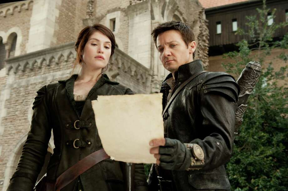 "Gemma Arterton, left, plays Gretel and Jeremy Renner plays Hansel in ""Hansel & Gretel: Witch Hunters,"" from Paramount Pictures and Metro-Goldwyn-Mayer Pictures. (David Appleby/Courtesy Paramount Pictures/MCT) Photo: HANDOUT, McClatchy-Tribune News Service / MCT"