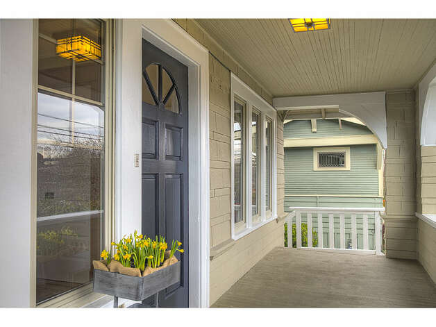 Front porch of 337 26th Ave. The 2,580-square-foot house, built in 1914, has four bedrooms, 1.75 bathrooms, exposed wood moldings, a skylight, a family room, a back deck and a patio on a 4,400-square-foot lot. It's listed for $520,000. Photo: Gregory White, Courtesy Diane Lancaster/Windermere Real Estate / (C) 2012 Gregory White