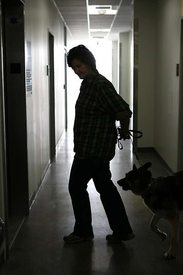 Kate O'Connor, the director of the new Dona Spring Animal Shelter, takes Greta, a one-year old German Shepard, on January 22, 2013 in Berkeley, Calif. The new shelter was the life's work of City Councilwoman Dona Spring, who died a few years ago. Photo: Sean Havey, The Chronicle
