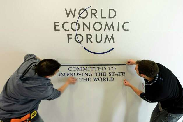 "Workers make the last preparations inside the Congress Center, on the eve of the opening of the 43rd Annual Meeting of the World Economic Forum, WEF, in Davos, Switzerland, Tuesday, Jan. 22, 2013. The overarching theme of the meeting, which will take place from 23 to 27 January, is ""Resilient Dynamism"". (AP Photo/Keystone, Laurent Gillieron) Photo: LAURENT GILLIERON, Associated Press / KEYSTONE"