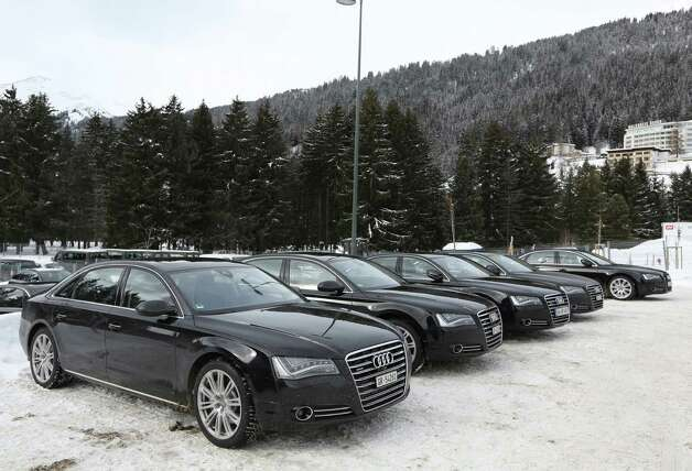 A fleet of Audi A8 Quattro's produced by Audi AG and used as VIP transport during the World Economic Forum (WEF) are seen in Davos, Switzerland, on Tuesday, Jan. 22, 2013. World leaders, Influential executives, bankers and policy makers arrive in the Swiss Alps for the 43rd annual meeting of the World Economic Forum in Davos, the five day event runs from Jan. 23-27. Photographer: Chris Ratcliffe/Bloomberg Photo: Chris Ratcliffe, Bloomberg / Copyright 2013 Bloomberg Finance LP, All Rights Reserved.