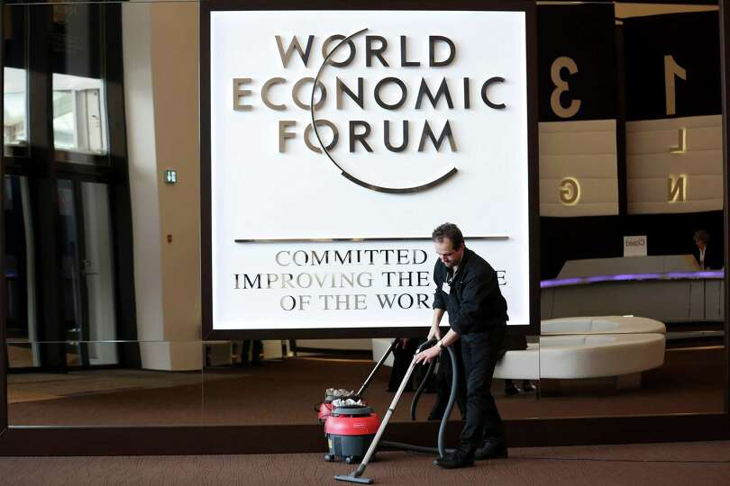A worker uses a vacuum cleaner in the main entrance area of the Congress Center, the venue for the W