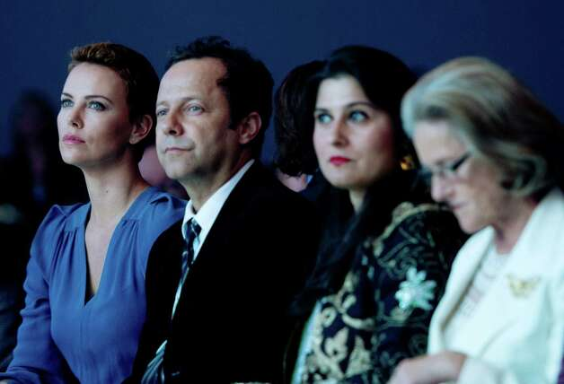 The three Chrystal award winners (L-R) South African actress Charlize Theron, Brazilian artist Vik Muniz, Pakistani documentary filmmaker Sharmeen Obaid Chinoy and Chairperson and Co-Founder of the Schwab Foundation for Social Entrepreneurship, Hilde Schwab await the presentation of the Crystal Award ceremony of the World Economic Forum (WEF) on January 22, 2013 at the Swiss resort of Davos. The WEF will take place from January 23 to 27. AFP PHOTO / JOHANNES EISELEJOHANNES EISELE/AFP/Getty Images Photo: JOHANNES EISELE, AFP/Getty Images / AFP