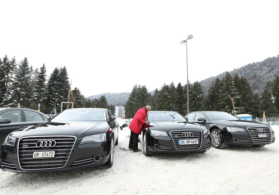 A fleet of Audi A8 Quattro automobiles, produced by Audi AG and used as VIP transport during the World Economic Forum (WEF), are seen in Davos, Switzerland, on Tuesday, Jan. 22, 2013. World leaders, influential executives, bankers and policy makers arrive in the Swiss Alps for the 43rd annual meeting of the World Economic Forum in Davos, the five day event runs from Jan. 23-27. Photographer: Chris Ratcliffe/Bloomberg Photo: Chris Ratcliffe, Bloomberg / Copyright 2013 Bloomberg Finance LP, All Rights Reserved.