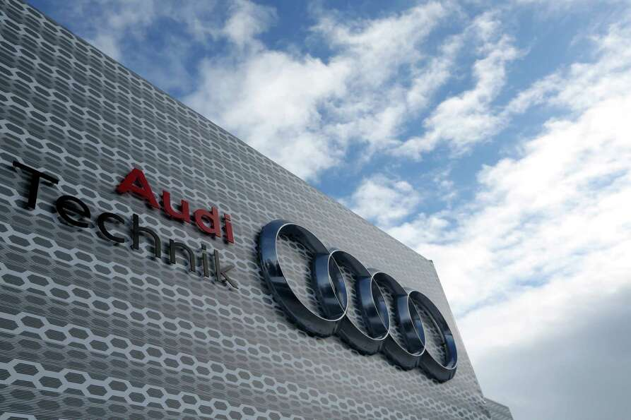 The Audi AG logo is seen displayed on the company's temporary stand during the World Economic Forum
