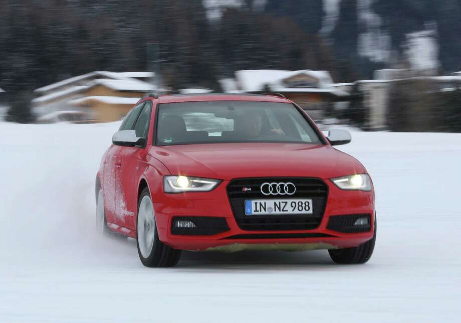 An Audi S4 automobile, produced by Audi AG, is driven across the ice track as part of the Audi driving experience during the World Economic Forum (WEF) meeting in Davos, Switzerland, on Tuesday, Jan. 22, 2013. World leaders, influential executives, bankers and policy makers arrive in the Swiss Alps for the 43rd annual meeting of the World Economic Forum in Davos, the five day event runs from Jan. 23-27. Photographer: Chris Ratcliffe/Bloomberg Photo: Chris Ratcliffe, Bloomberg / Copyright 2013 Bloomberg Finance LP, All Rights Reserved.
