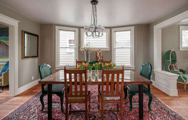 Dining room of 822 24th Ave. The 1,980-square-foot house, built in 1909, has three bedrooms, two bathrooms, a foyer, a den, a front porch and a back deck on a 2,400-square-foot lot. It's listed for $550,000, although a sale is pending. Photo: Aaron Leitz Photography/Courtesy Meredith Erickson/Madison House, Ltd.
