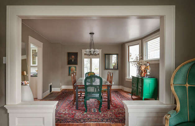 View from living room into dining room of 822 24th Ave. The 1,980-square-foot house, built in 1909, has three bedrooms, two bathrooms, a foyer, a den, a front porch and a back deck on a 2,400-square-foot lot. It's listed for $550,000, although a sale is pending. Photo: Aaron Leitz Photography/Courtesy Meredith Erickson/Madison House, Ltd.
