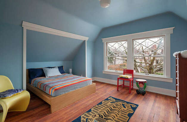 Bedroom of 822 24th Ave. The 1,980-square-foot house, built in 1909, has three bedrooms, two bathrooms, a foyer, a den, a front porch and a back deck on a 2,400-square-foot lot. It's listed for $550,000, although a sale is pending. Photo: Aaron Leitz Photography/Courtesy Meredith Erickson/Madison House, Ltd.