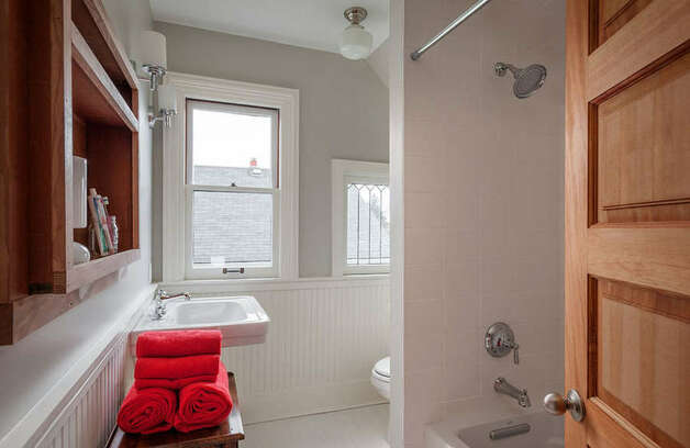Bathroom of 822 24th Ave. The 1,980-square-foot house, built in 1909, has three bedrooms, two bathrooms, a foyer, a den, a front porch and a back deck on a 2,400-square-foot lot. It's listed for $550,000, although a sale is pending. Photo: Aaron Leitz Photography/Courtesy Meredith Erickson/Madison House, Ltd.