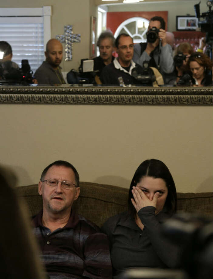 Mike Lovelady, left, sits with his niece Erin Lovelady as she talks to the media about her father, Victor Lovelady, Tuesday, Jan. 22, 2013, in Nederland, Texas. Victor Lovelady died in the attack at the Ain Amenas natural gas facility in the Algerian Sahara Desert. U.S. officials identified Lovelady on Monday as the second Texan to have died in the standoff.