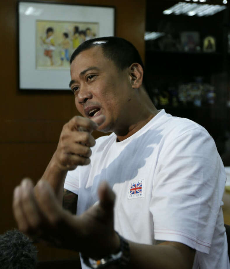 Joseph Balmaceda, one of the four Filipino oil field workers who was wounded but survived the terrorist attacks of an oil field in Algeria, talks about his ordeal shortly upon arrival at the Overseas Workers Welfare Administration in Manila, Philippines Monday Jan. 21, 2013.