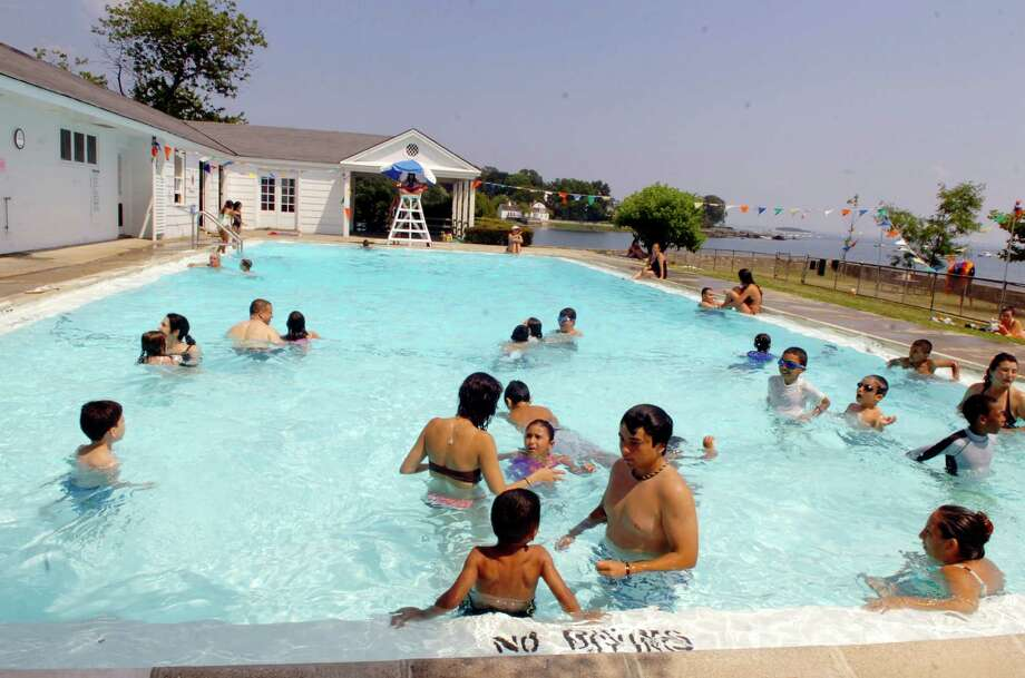 The Byram Pool was filled to capacity on a hot July day in 2010. Photo: Helen Neafsey, Greenwich Time / Greenwich Time