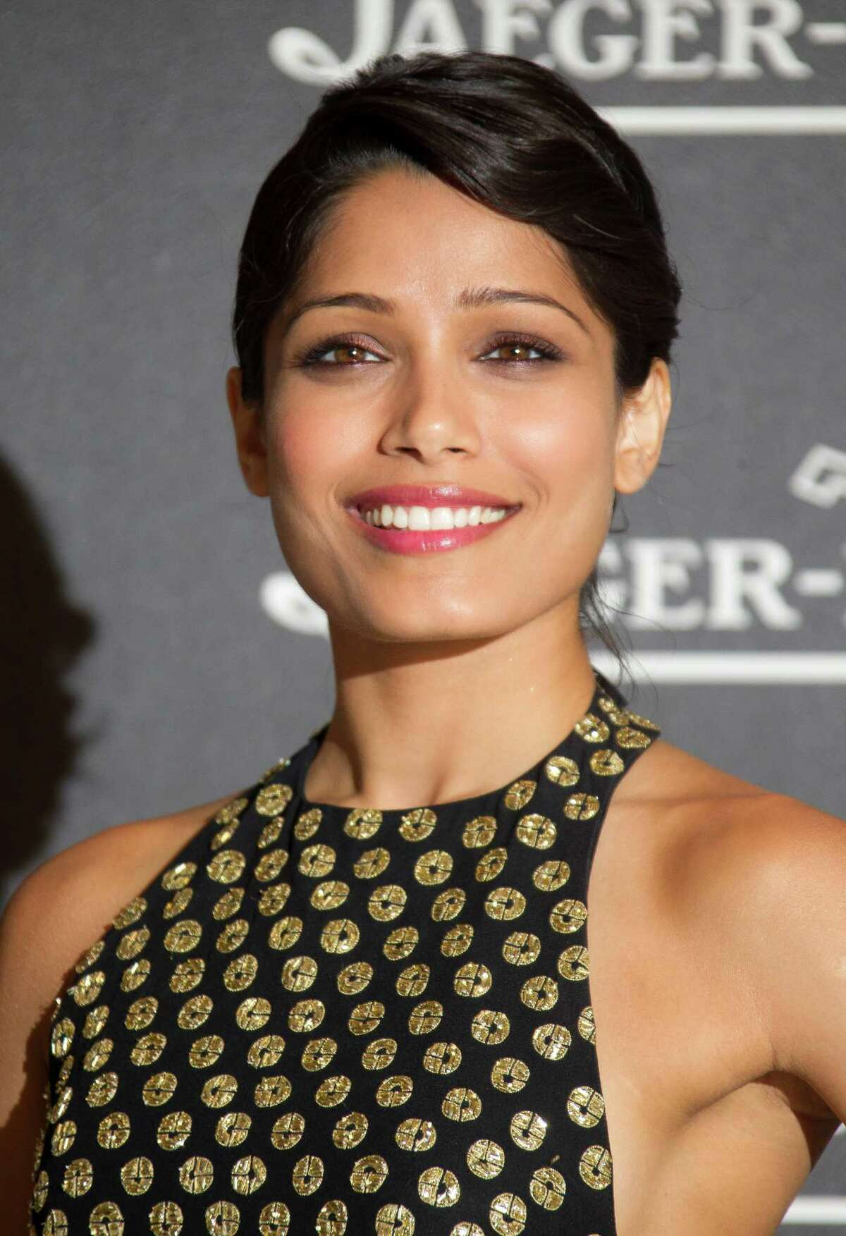 FILE - In a Tuesday, Sept. 4, 2012 file photo, actress Freida Pinto arrives for a party in Venice, Italy. Pinto introduced ?Girl Rising?, Richard Robbins' new movie, Monday, Jan. 21, 2013 at Sundance Film Festival by sharing some powerful statistics: There are 66 million girls who are not in school; 14 million girls under 18 who will be married this year; and 150 million girls are victims of sexual violence each year. (AP Photo/Joel Ryan, File)