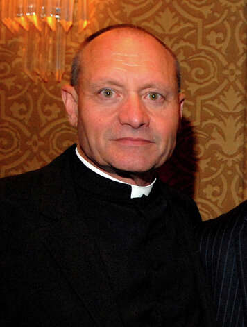Former Monsignor Kevin Wallin Photo: File Photo / Connecticut Post File Photo