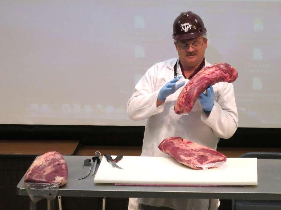 Davey Griffin, associate professor in the meat science section of Department of Animal Science at Texas A&M lectures on brisket at 2013 Camp Brisket sponsored by Foodways Texas at Texas A&M University. Photo: Jim Gossen / handout