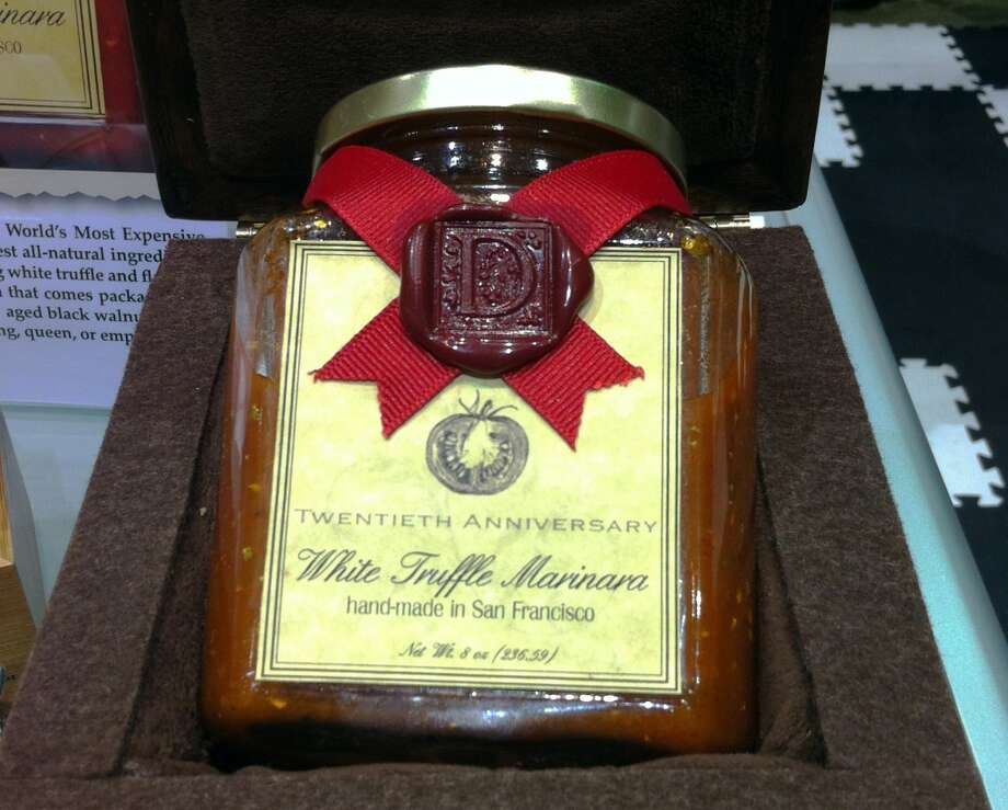 This is a very expensive pasta sauce. It costs $1,000 per bottle. It is a marinara sauce with white truffle and gold flecks, and it comes in an antique wooden box.