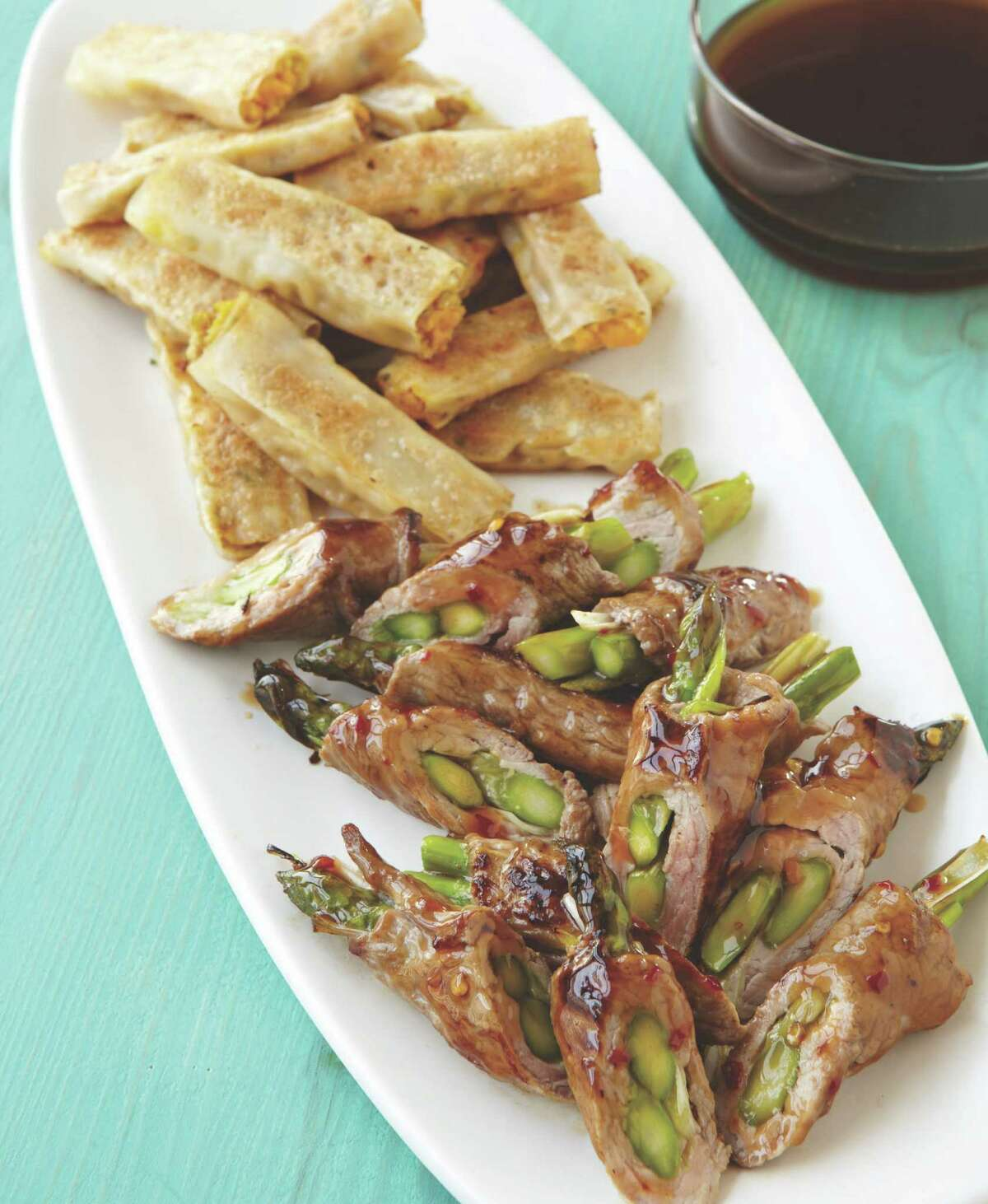 Beef and Asparagus Rolls (shown with Lamb Wonton Pot Stickers.