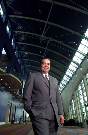 Henry Muñoz poses on Sept. 7, 2000, inside the recently completed section of the Henry B. Gonzalez Convention Center. Photo: WILLIAM LUTHER, SAN ANTONIO EXPRESS-NEWS / SAN ANTONIO EXPRESS-NEWS