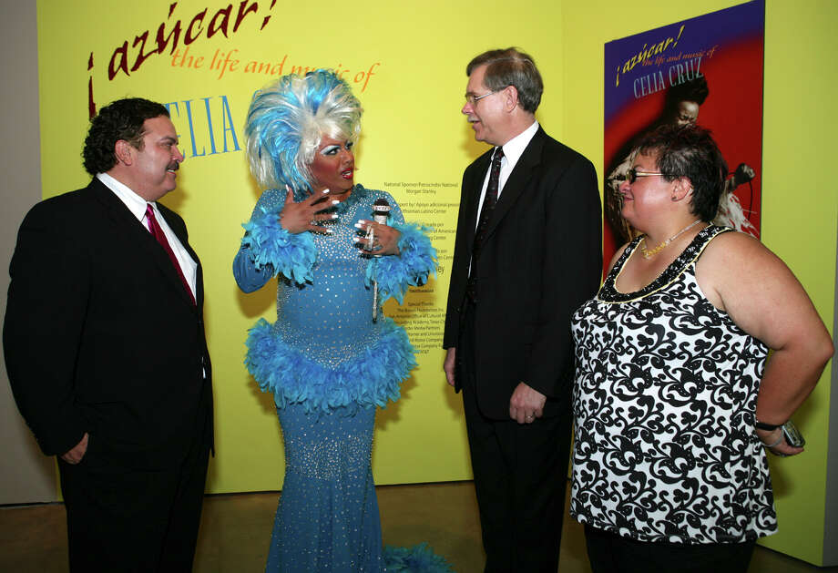 """Henry R. Muñoz III, Museo Alameda founder, Layla Larue, Celia Cruz impersonator, Jeffrey Post, director of gemology Smithsonian Institute, and Marvette Perez, show curator, curator Smithsonian Museum of American History, were at the Museo Alameda on Sept. 26, 2007, for """"Azucar! The Life and Music of Celia Cruz"""" exhibit. Photo: LELAND A. OUTZ, SPECIAL TO THE EXPRESS-NEWS / SAN ANTONIO EXPRESS-NEWS"""