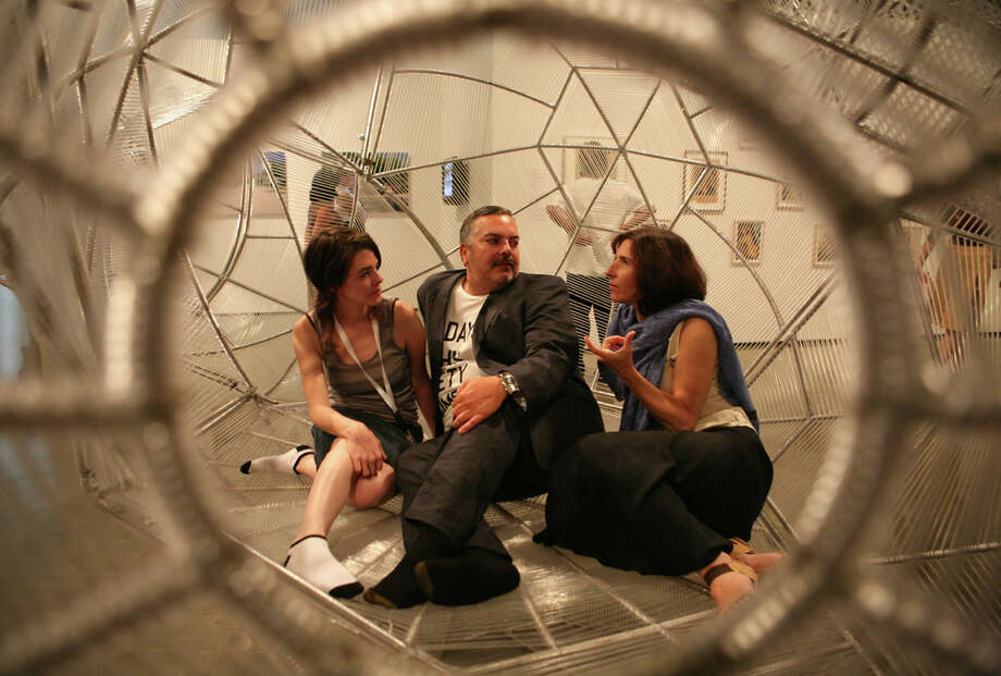 Maria Alós, performance artist, Henry R. Muñoz III, founding chair of Museo Alameda, and Elizabeth Smith, chief curator of the Museum of Contemporary Art, Chicago, were inside one of the exhibits at the Mexico at the Museo exhibit on July 31, 2008, at the Museo Alameda. Photo: LELAND A. OUTZ, SPECIAL TO THE EXPRESS-NEWS / SAN ANTONIO EXPRESS-NEWS
