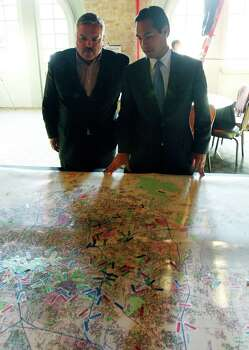 VIA Board of Trustees Chairman Henry R. Muñoz III (left) and Mayor Julian Castro look at a map of the area showing where people live and work during the VIA SmartWay SA closing public meeting held Thursday Sept. 3, 2009 at Sunset Station. SmartWay SA is VIA's process for working with the community on a Long Range Comprehensive Transportation Plan (LRCTP) for San Antonio and the Bexar County area. Photo: EDWARD A. ORNELAS, SAN ANTONIO EXPRESS-NEWS / eaornelas@express-news.net