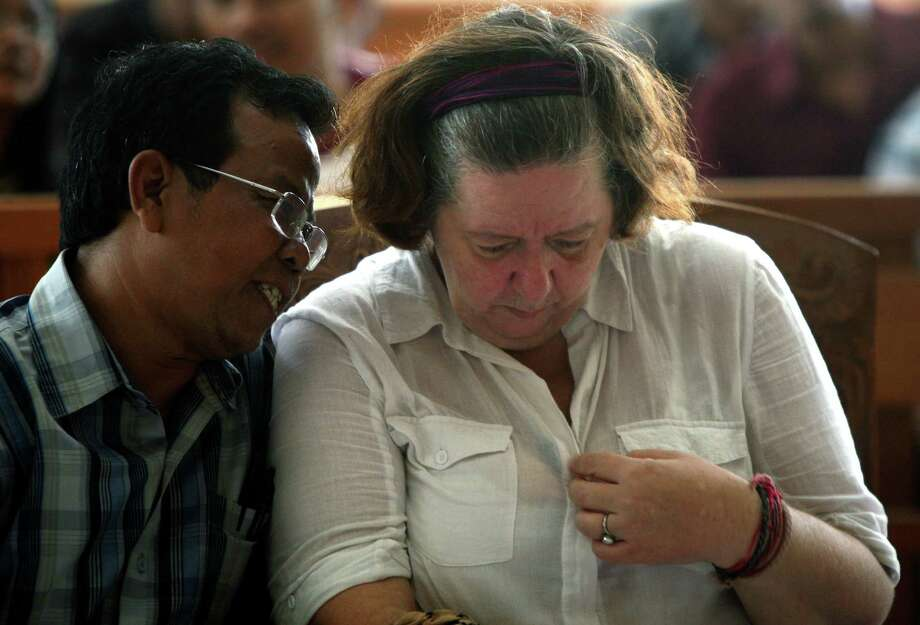 Lindsay June Sandiford, of Britain, listens to her Indonesian interpreter as her death sentence is announced at a courthouse in Bali on Tuesday. Photo: Firdia Lisnawati, STR / AP