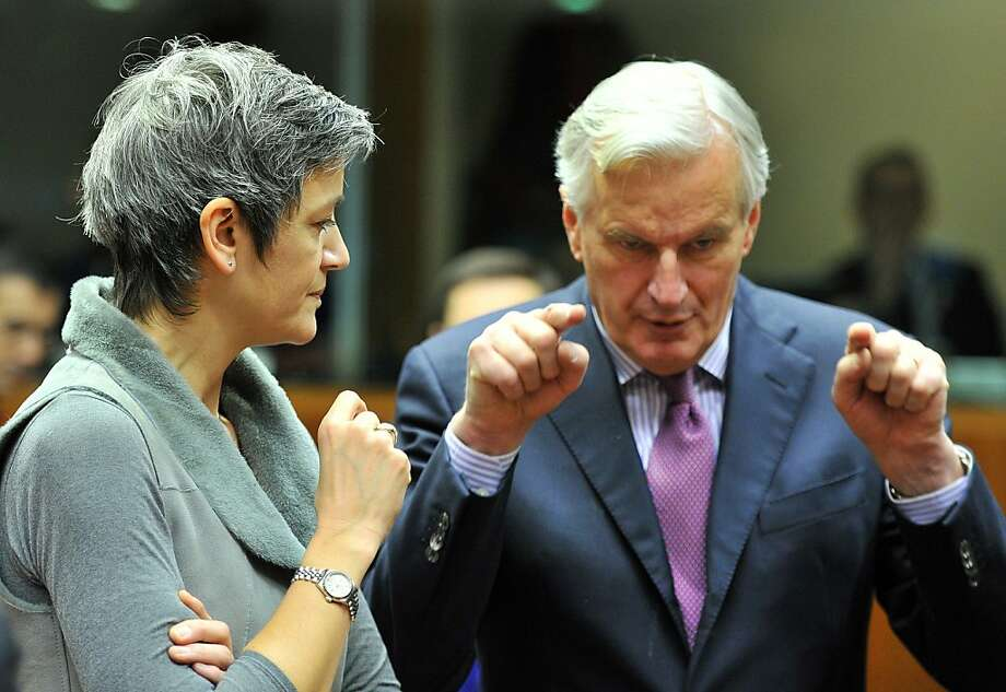 Danish Economy Minister Margrethe Vestager (L) and EU internal market and services commissioner Michel Barnier talk on January 22, 2013 before an Economic and Financial  Affairs Council  at EU headquarters in Brussels. EU finance ministersare expected to approve a financial transactions tax requested by 11 European Union nations. AFP PHOTO / GEORGES GOBETGEORGES GOBET/AFP/Getty Images Photo: Georges Gobet, AFP/Getty Images