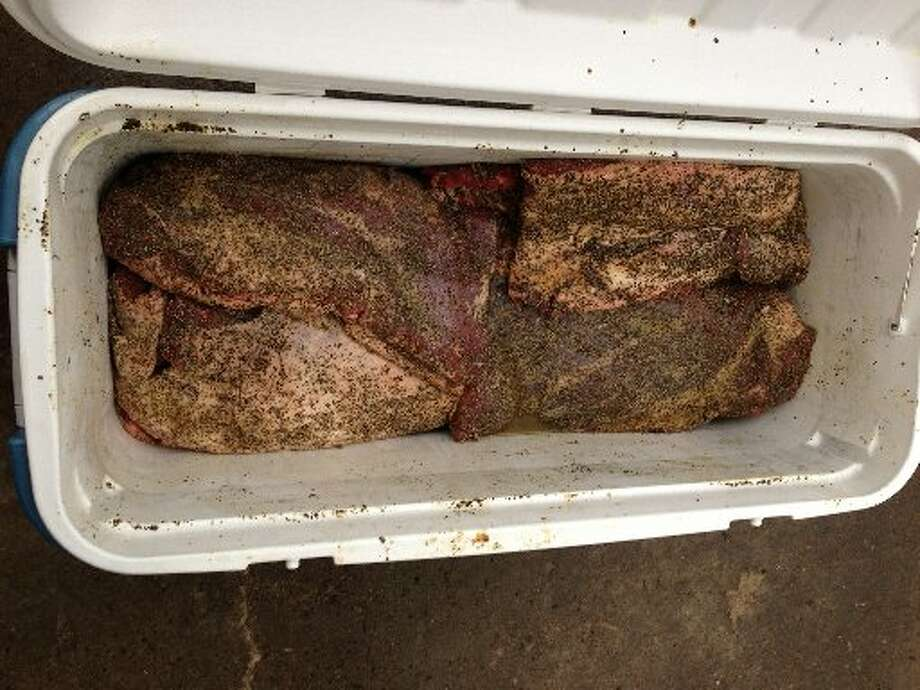 Brisket being prepared. Photo: Greg Morago