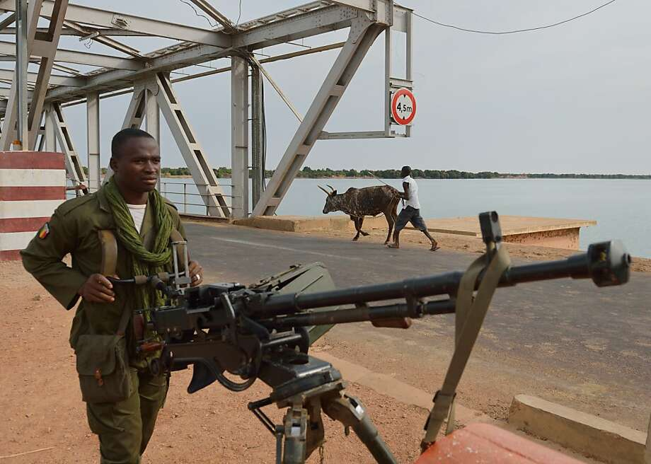 A Malian soldier guards a Niger River bridge near Markala, north of the capital of Bamako. Photo: Eric Feferberg, AFP/Getty Images