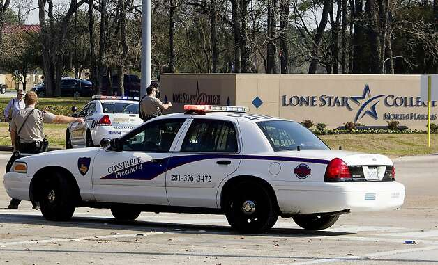 Police block off an entrance to Lone Star College's north Harris County campus in suburban Houston. Photo: Patric Schneider, Associated Press