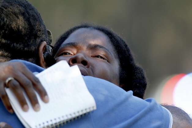 Lone Star College freshman Sheketa Taylor hugs her father, Judson Gimblin, after they found each other on the campus, which had been closed after the shooting. Photo: Thomas B. Shea, Getty Images