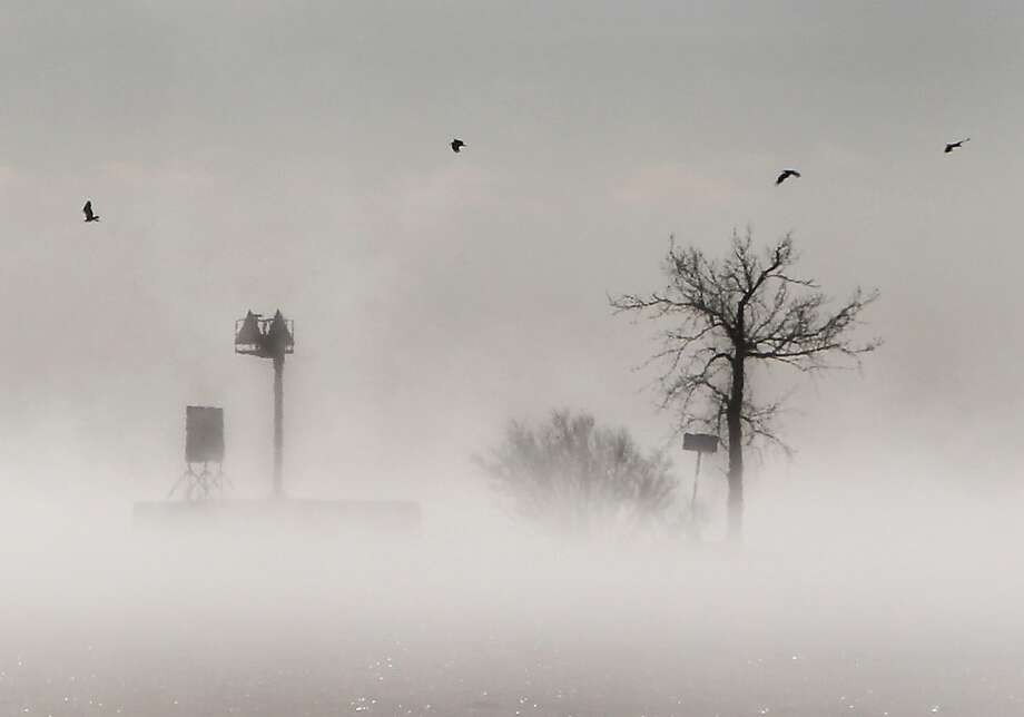 Fog gathers over Lake Winnebago in Menasha, Wis., on a third-straight day of frosty weather. Photo: William Glasheen, Associated Press
