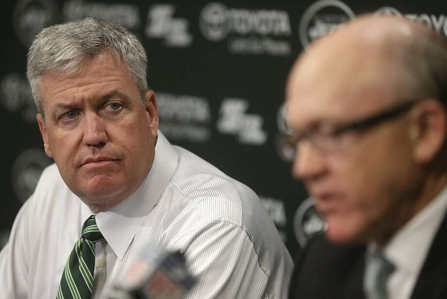 New York Jets head coach Rex Ryan, left, looks on as team owner Woody Johnson speaks during an NFL Football news conference, Tuesday, Jan. 8, 2013 in Florham Park, NJ.  (AP Photo/Seth Wenig) Photo: Seth Wenig, Associated Press