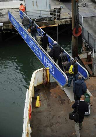 Passengers disembark from the Bridgeport/Port Jefferson ferry in Bridgeport on Tuesday, January 15, 2013. Photo: Brian A. Pounds