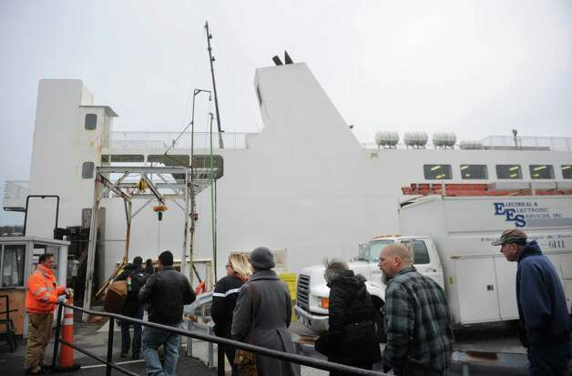 Passengers board the Bridgeport/Port Jefferson ferry in Port Jefferson, NY on Tuesday, January 15, 2013. Photo: Brian A. Pounds