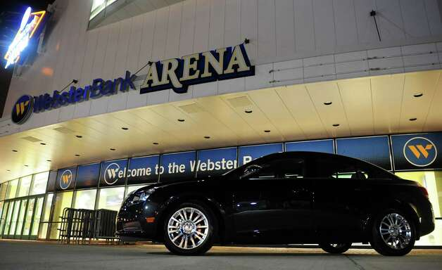 A Chevy Cruze is parked in front of the Webster Bank Arena in Bridgeport, Conn. Tuesday, Jan. 22, 2013.  An unidentified male fan hit a half-court shot to win the car at halftime during the Fairfield University menâÄôs basketball game Monday night. Photo: Autumn Driscoll / Connecticut Post