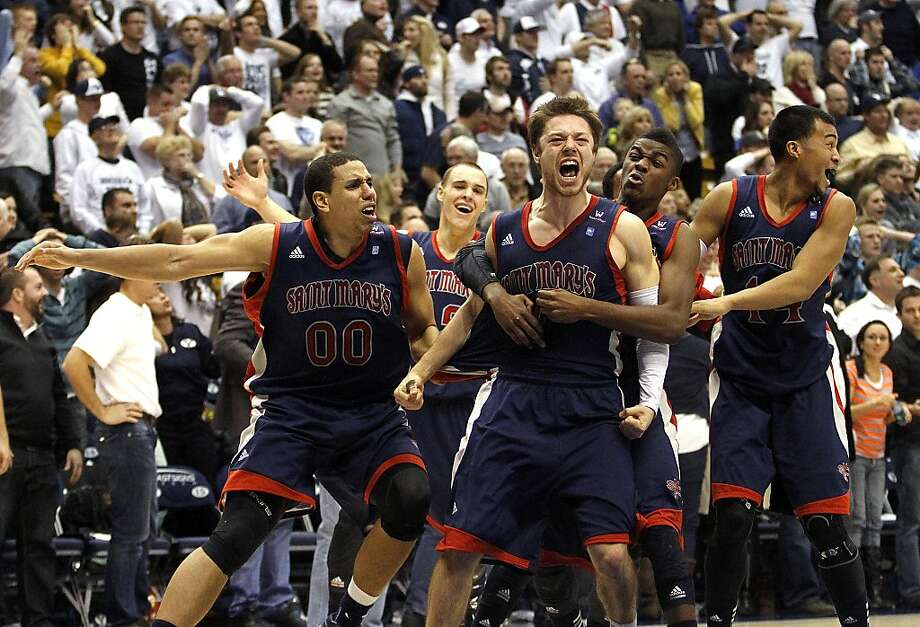 Matthew Dellavedova (4) of Saint Mary's celebrates his last-second basket with his teammates at the end of the second half of the game against BYU at the Marriott Center in Provo on Wednesday, Jan. 16, 2013. Saint Mary's won 70-69. (AP Photo/The Daily Herald, Sarah Weiser) Photo: Sarah Weiser, Associated Press