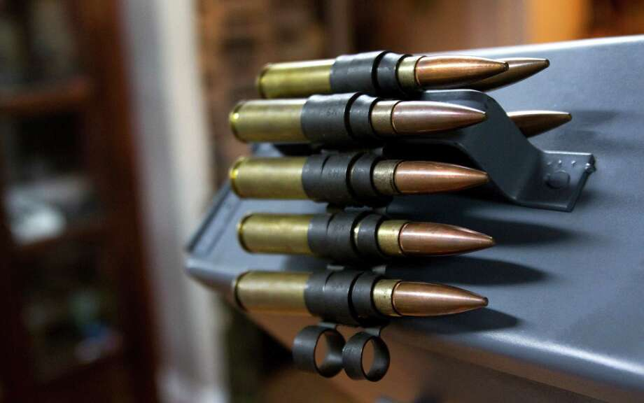 A belt of 50-caliber bullets are shown at Houston Armory Tuesday, Jan. 8, 2013, in Stafford. Houston Armory buys an sells, as well as manufactures weapons permitted and strictly controlled by the U.S. government, including machine guns, silencers and other specialty items. ( Brett Coomer / Houston Chronicle ) Photo: Brett Coomer, Houston Chronicle / © 2013 Houston Chronicle