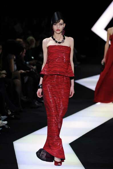 A model wears a creation by fashion designer Giorgio Armani.