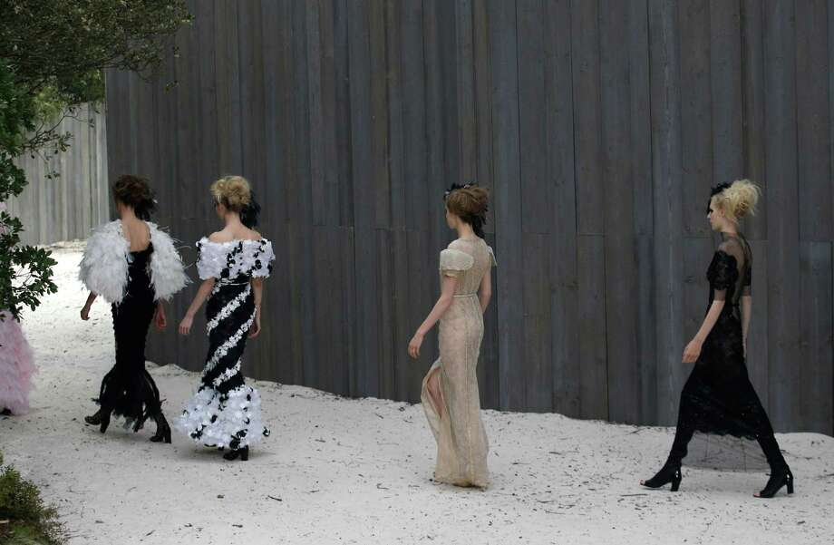 Models wear creations by German fashion designer Karl Lagerfeld for Chanel. Photo: AP