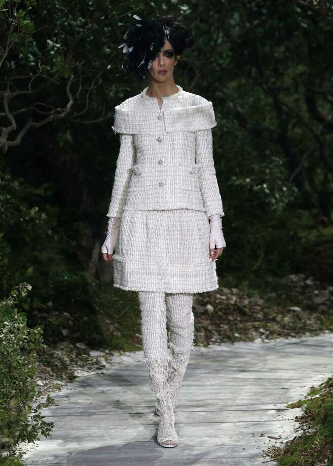 A model presents a creation by German fashion designer Karl Lagerfeld for Chanel. Photo: AP
