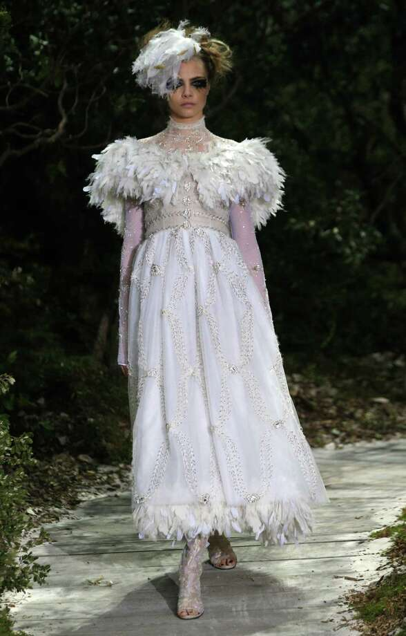 A model wears a creation by German fashion designer Karl Lagerfeld for Chanel. Photo: AP