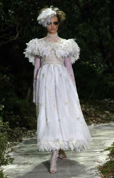 A model wears a creation by German fashion designer Karl Lagerfeld for Chanel.