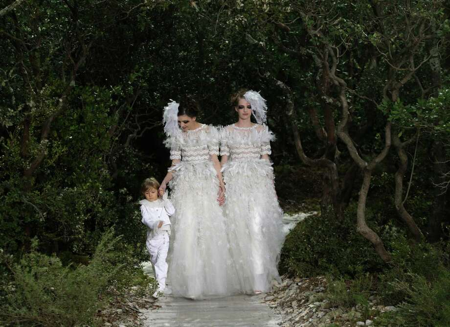 Models wear wedding gowns by German fashion designer Karl Lagerfeld for Chanel. Photo: AP