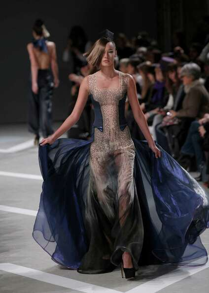 A model presents a creation by French fashion designer Julien Fournie.