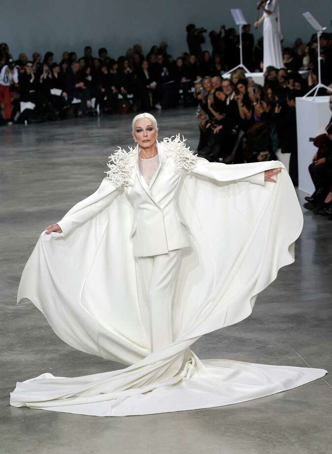 American model and actress Carmen Dell'Oresice, 82, presents a creation by French fashion designer Stephane Rolland. Photo: AP