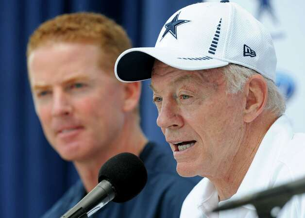Cowboys owner Jerry Jones (right) says his decision to strip Jason Garrett of play-calling duties next season isn't a reflection on his coach. Photo: Gus Ruelas, Associated Press / FR157633 AP