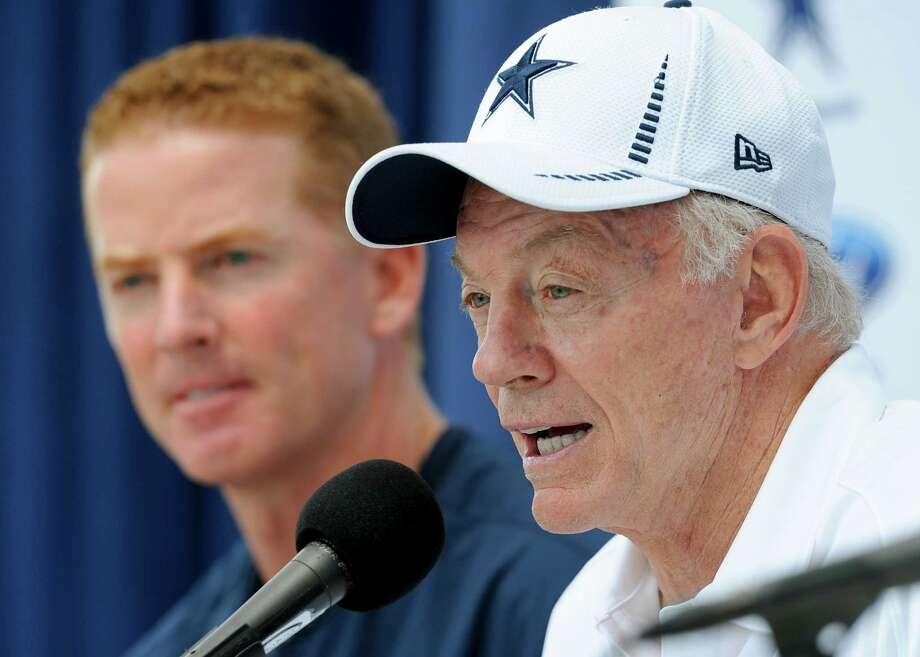 Cowboys owner Jerry Jones (right) says his decision to strip Jason Garrett of play-calling duties next season isn't a reflection on his coach. Photo: Gus Ruelas, Associated Press / FR157633 AP